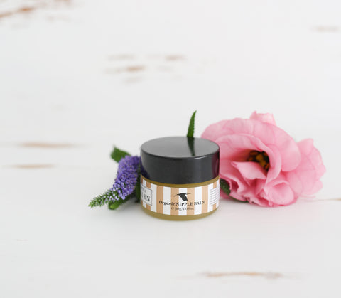 Organic Natural Nipple Balm in small tub with pink and purple flowers