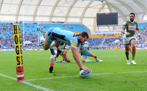 Anthony Don, NRL Gold Coast during NRL game placing the ball down for a try.