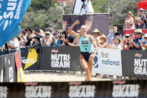 Harriet Brown winning NutriGrain Ironwoman Series at finish line