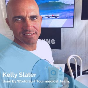 Kelly Slater holding Blue Healer Care tubes on WSL Tour