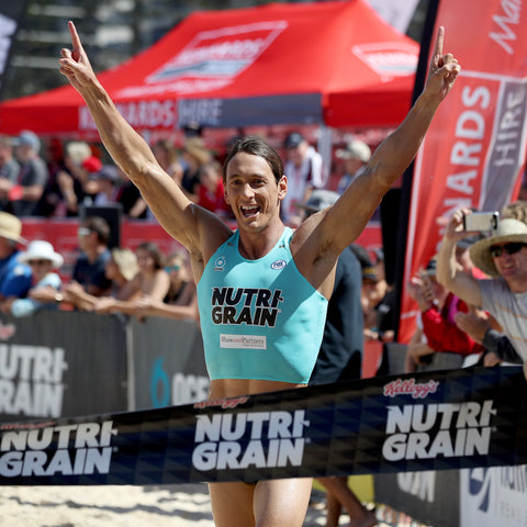 Ali Day winning Nutri-Grain Ironman Series in Dec 2018 crossing the finish line |Blue Healer care