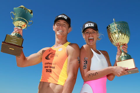 Ali Day and Courtney Hancock holding Champion Trophies after winning Coolangatta Gold race