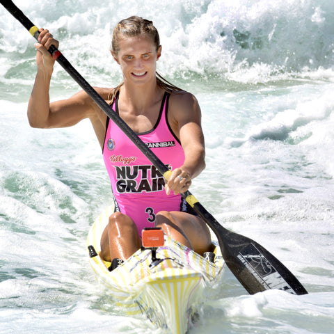 Harriet Brown paddling in the surf during NutriGrain Ironwoman Challenge