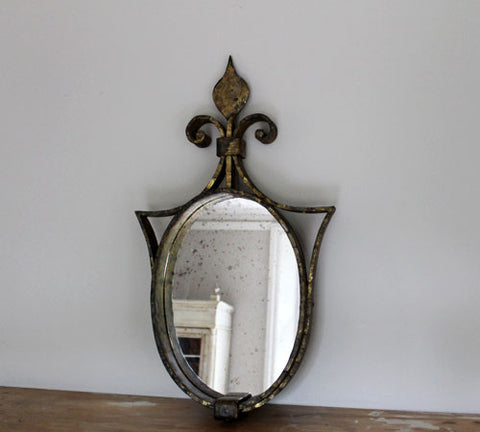 A Metal Framed Heart Shaped Mirror Surround with Fleur de Lys Detail