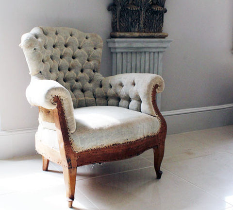 A pair of button backed Antique French Armchairs