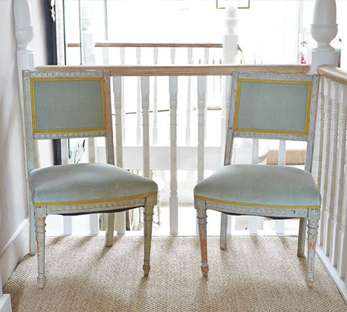 A pair of French painted chairs