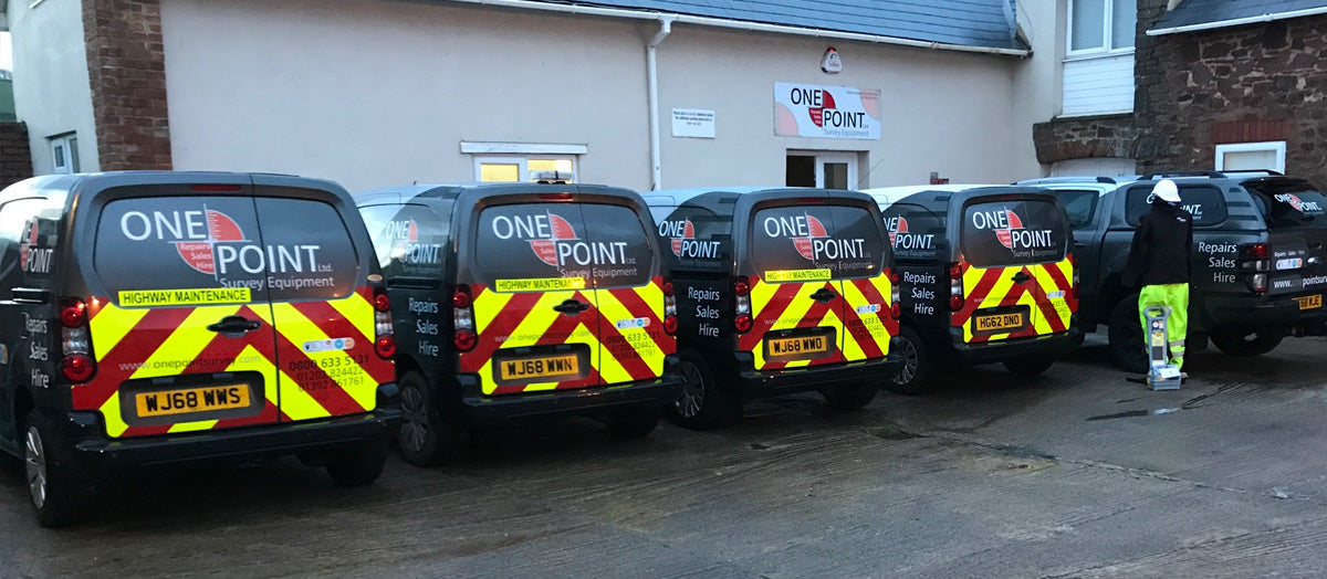 One + Point Ltd van alongside staff and level.
