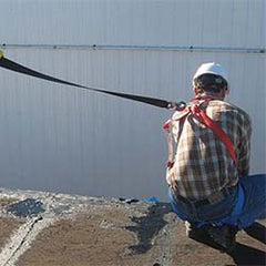 A worker onsite using a safety harness - available at One Point Survey.
