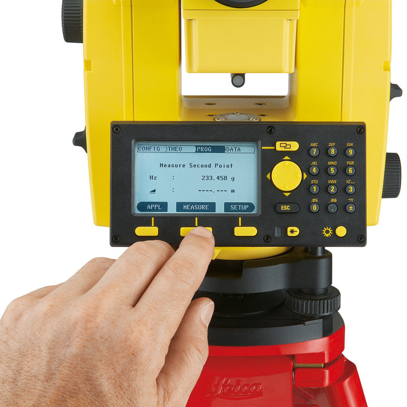 Someone using the keypad on the Leica Builder 400 Theodolite