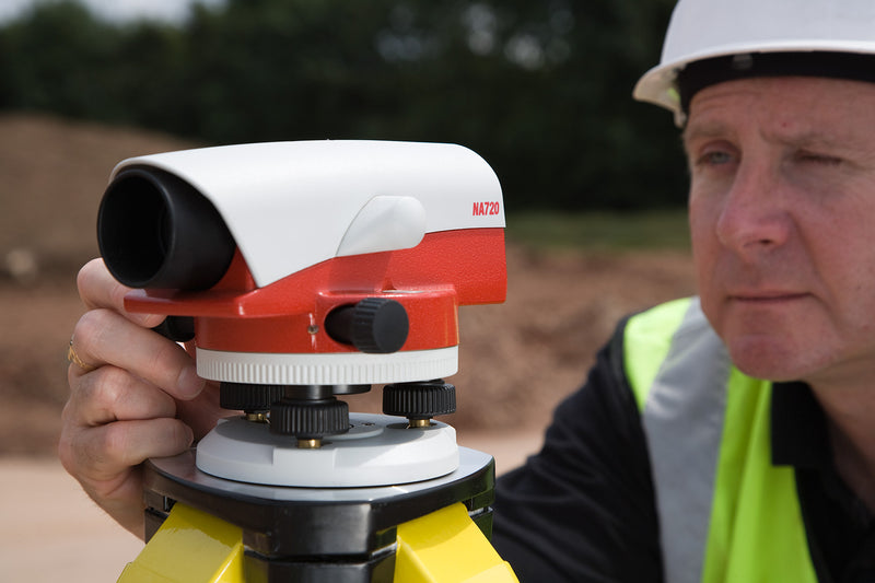 Leica NA728 Automatic Level being used on a construction site