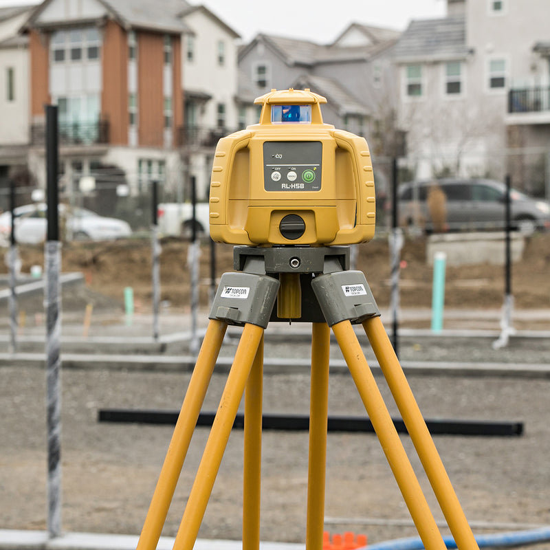Topcon RL-H5B Rotating Laser Level with tripod on worksite