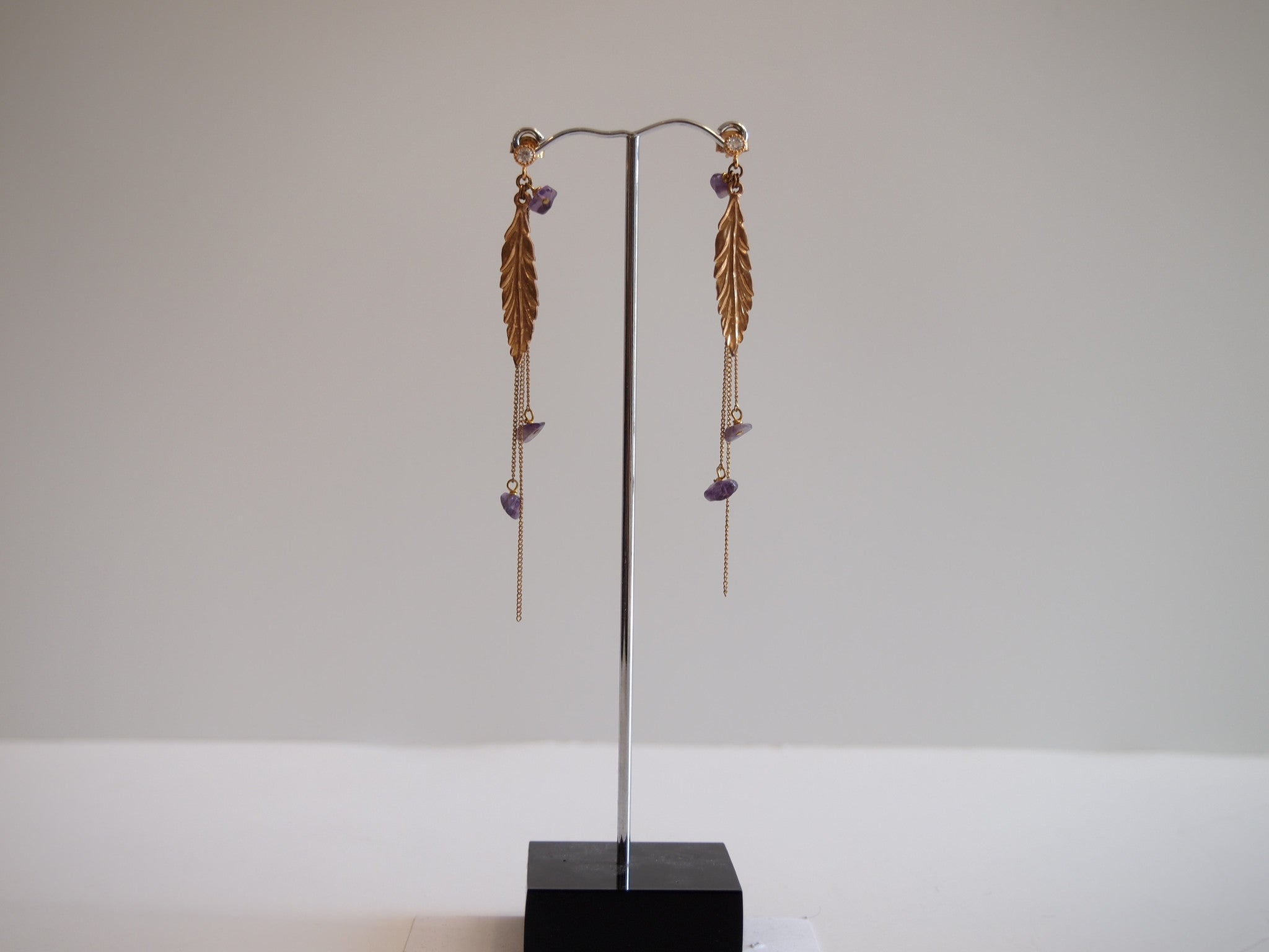 Handmade earrings with purple amethyst with gold-plated leaf design
