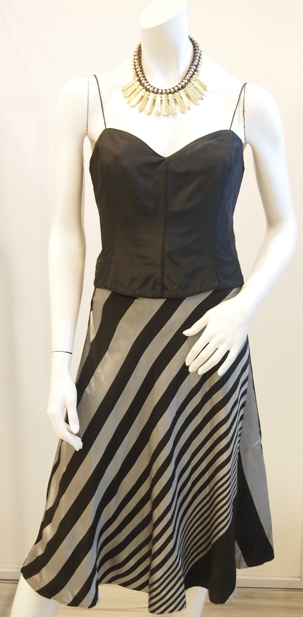 Black bustier with silver black diagonal stripe skirt