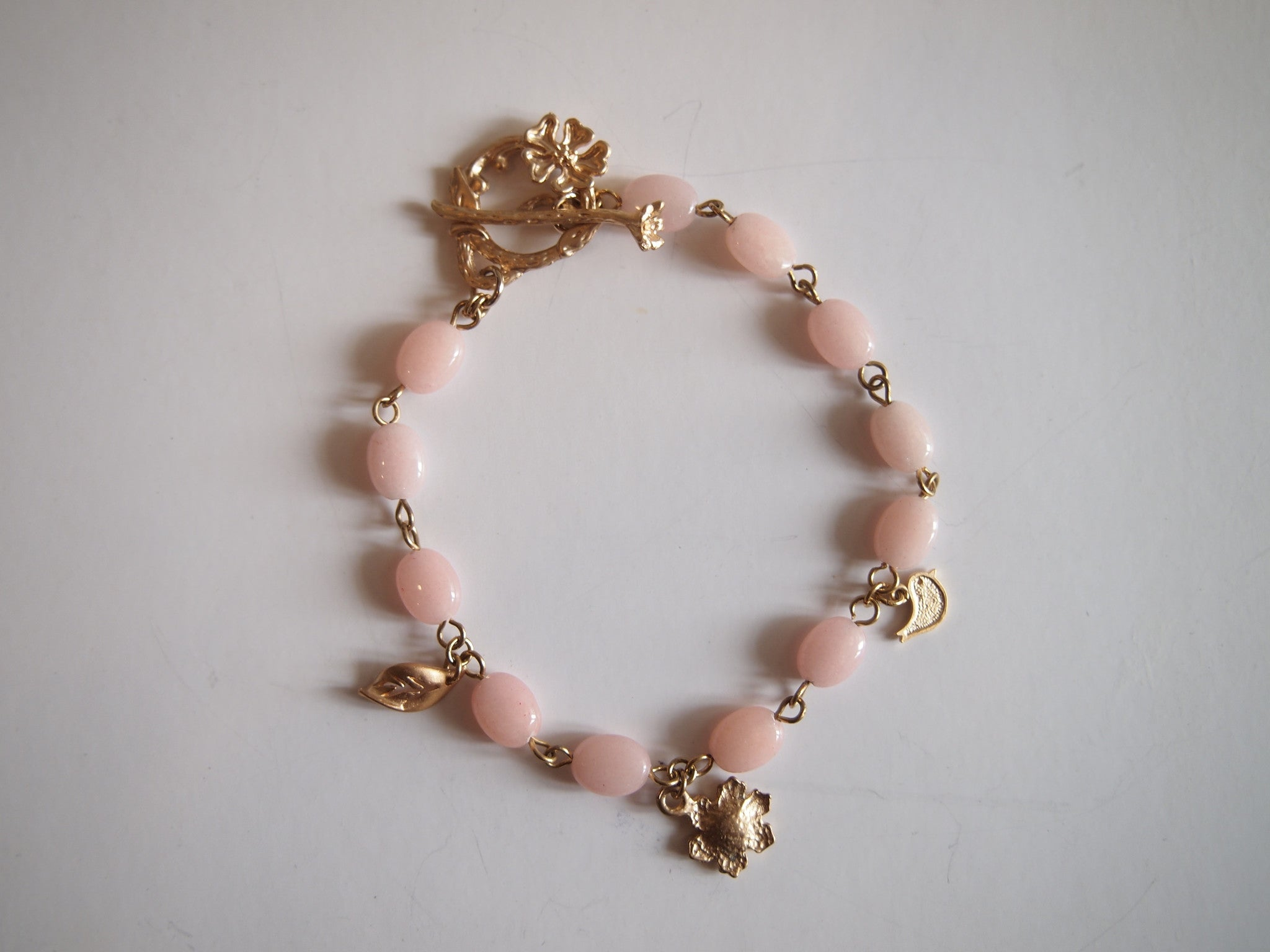 Handmade jewelry bracelet with pink quartz and tree charm