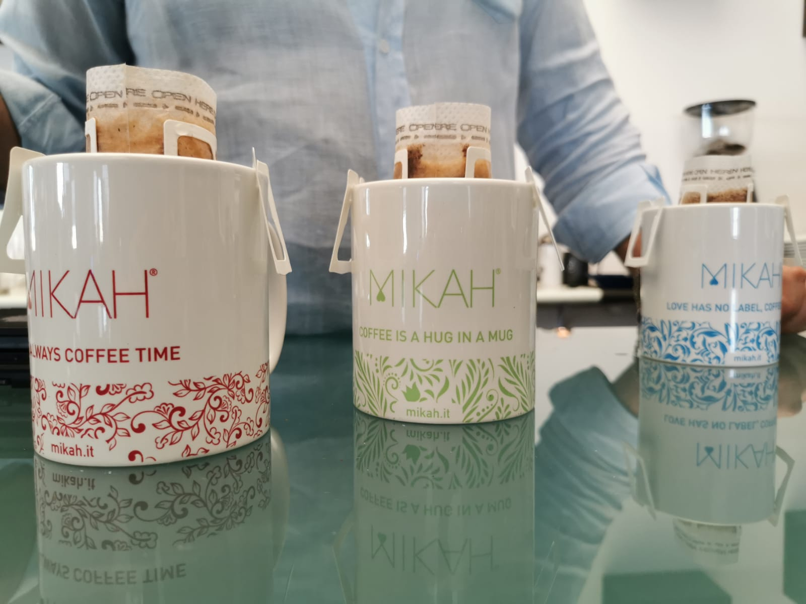 three mikah specialty coffee mugs with ear hanging coffee filter