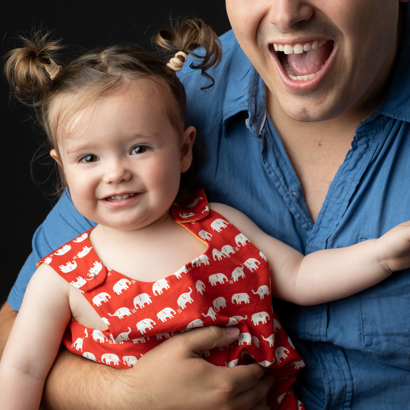 Dad_in_blue_shirts_squeezing_girl_in_red_dress_tightly2.jpg