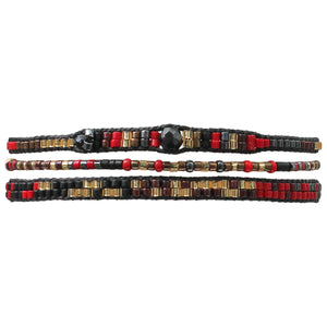 SET OF THREE HANDWOVEN BEADED BRACELETS IN GOLD AND RED