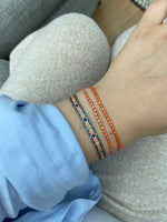 HANDWOVEN INTERMIXED BRACELET IN ORANGE & BLUE TONES