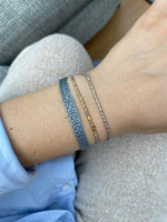 THIN BRACELET IN OYSTER GREY & GOLD