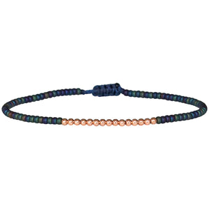 PETITE BRACELET IN IRIDESCENT BLUE BEADS AND 14K ROSE GOLD FILLED DETAILS