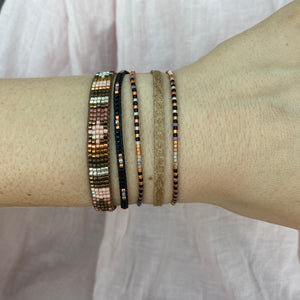SET OF THREE BRACELETS IN BLACK AND NUDE TONES