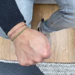 HANDWOVEN BRACELET FOR HIM IN ORANGE TONES AND GOLD DETAILS