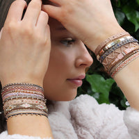 HANDWOVEN SET OF THREE BRACELETS WITH ROSE GOLD DETAILS