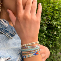 HANDWOVEN SET OF TWO BRACELETS IN TURQUOISE, BEIGE AND SILVER TONES