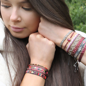 SET OF THREE HANDWOVEN BRACELETS IN BURGUNDY, PINK AND SILVER TONES
