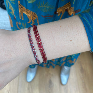 INTERMIXED HANDWOVEN BRACELET IN RED AND GREY TONES