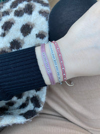 ZIP BRACELET IN PINK AND SILVER TONES