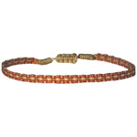 BASIC HANDWOVEN BRACELET IN TONES OF ORANGE, BEIGE & GOLD