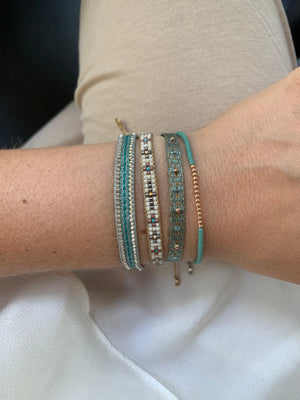 SET OF TWO HANDWOVEN BRACELETS IN NEUTRAL AND AQUA TONES