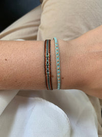 HANDWOVEN BRACELET IN COPPER TONES WITH TURQUOISE