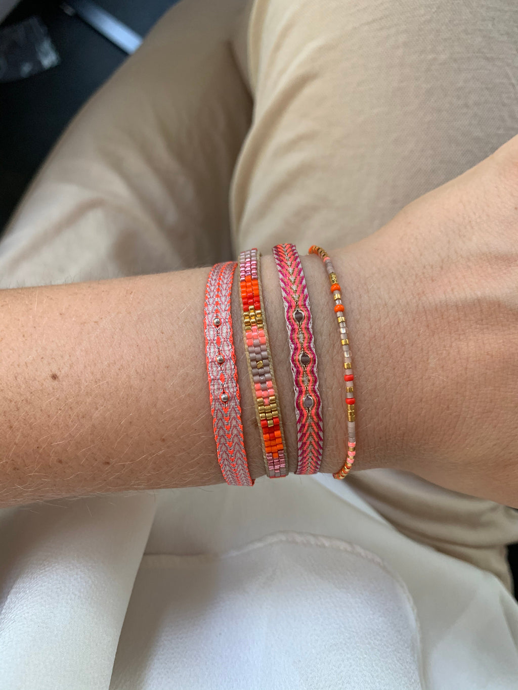SET OF THREE BRACELETS IN PINK AND ORANGE TONES
