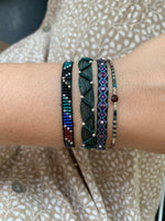 SET OF THREE HANDWOVEN BRACELETS IN DARK TONES WITH SILVER DETAILS