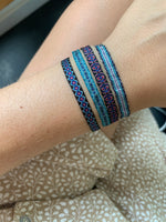 SET OF FOUR BASIC BRACELETS IN DARK BLUE AND PURPLE TONES