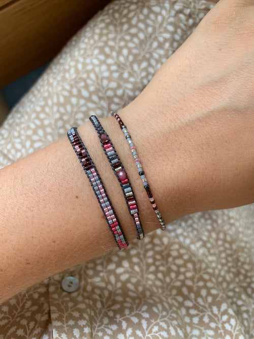 SET OF THREE HANDWOVEN BEADED BRACELETS IN PINK AND GREY