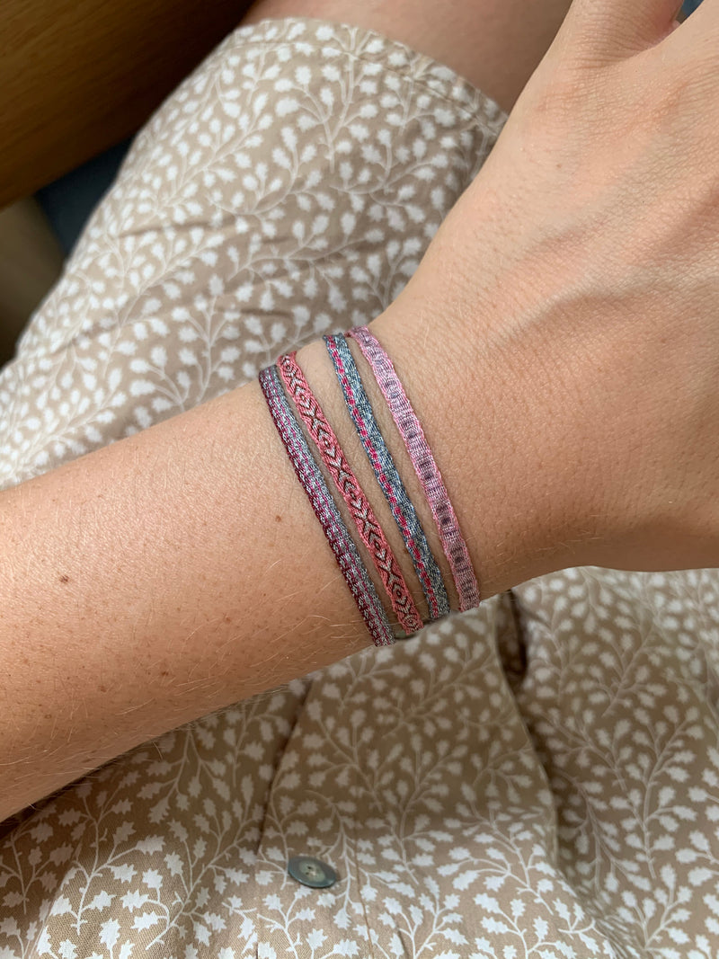 SET OF FOUR BASIC BRACELETS IN PINK AND SILVER TONES