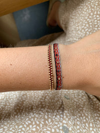 HANDWOVEN BRACELET WITH INTERMIXED STONES IN RED AND BLACK