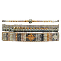 HANDWOVEN SET OF THREE MIXED BRACELETS IN BLACK,GOLD AND BEIGE TONES