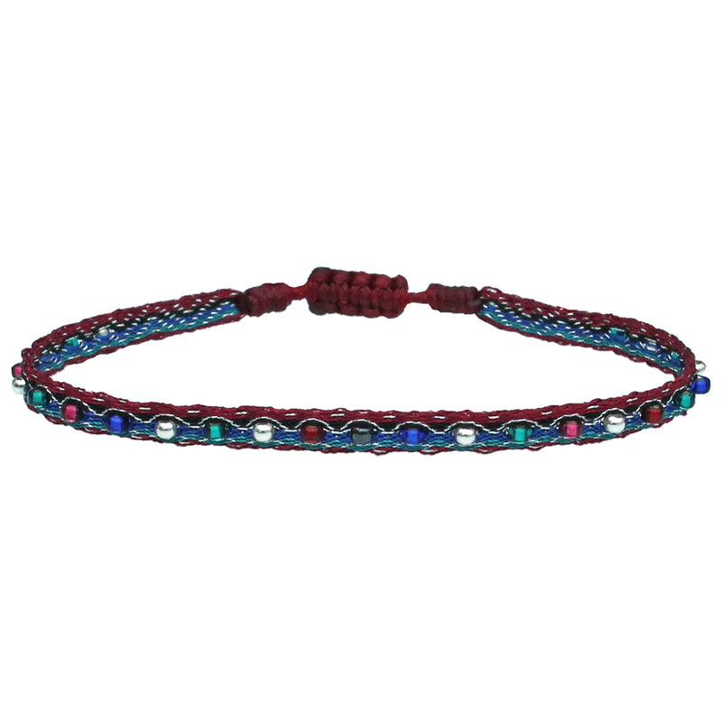 COLOURFUL HANDWOVEN BRACELET IN RED TONES AND SILVER DETAILS