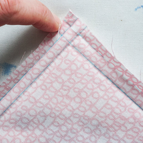 a mitered hem on a napkin or garment