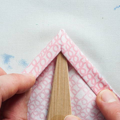sew a mitered corner on a double fold hem