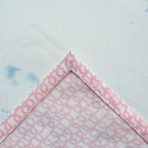fold a mitered corner on a double fold hem.