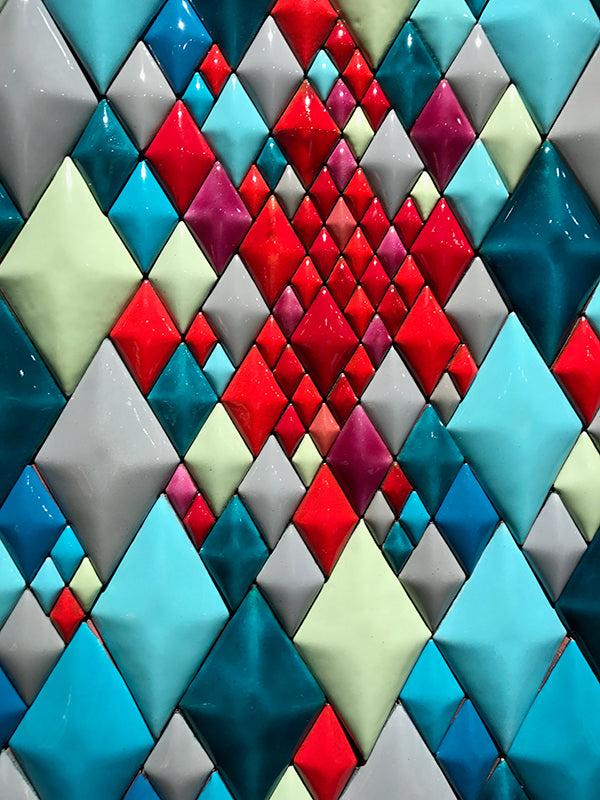 detail of blue, aqua, yellow, red, green diamonds in contemporary copper wall art