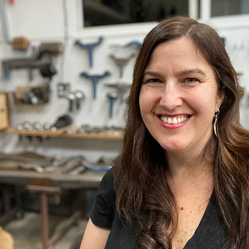 Catherine Grisez in art studio where she makes metal sculpture and jewelry inspired by nature