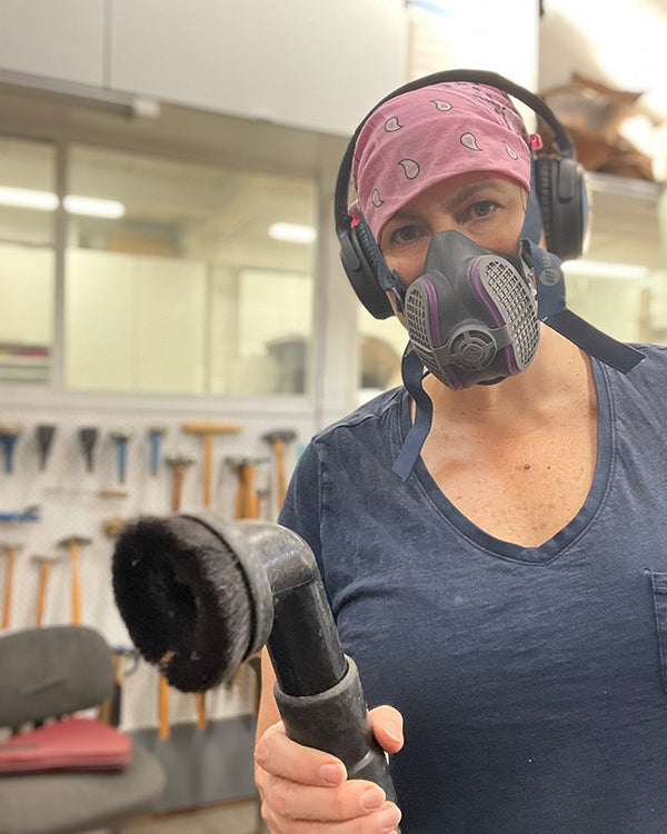 Catherine Grisez cleaning CG Sculpture and Jewelry studio