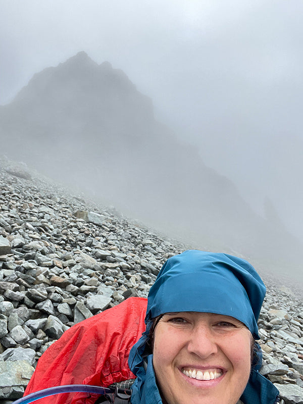 Catherine Grisez hiking in a cloud up a mountain on the PCT in Washington