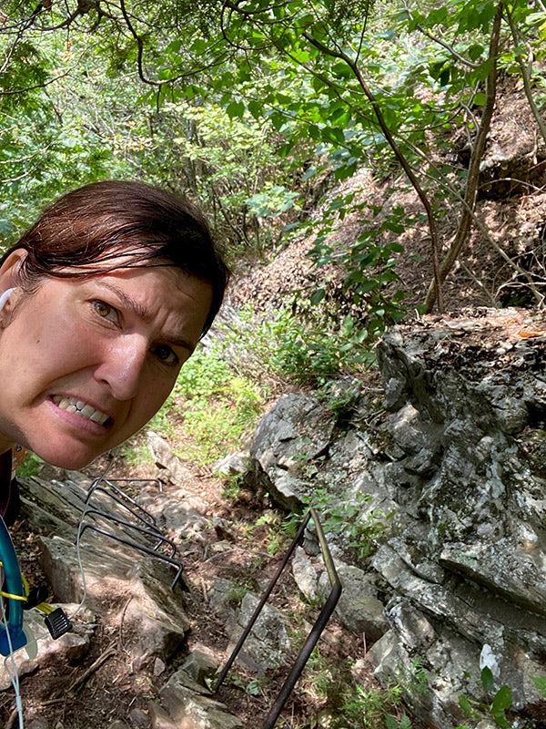 nervous catherine on steep section of appalachain trail hike with metal bars to assist